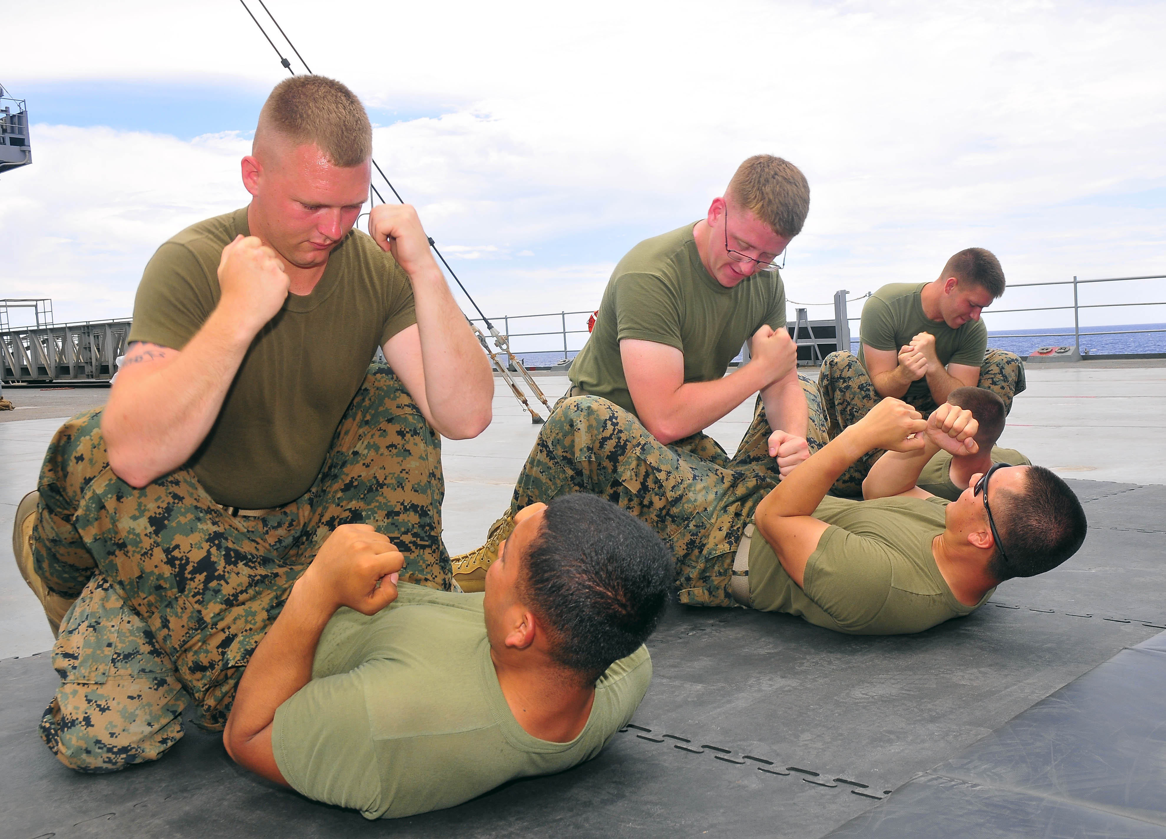 http://upload.wikimedia.org/wikipedia/commons/e/ed/130528-N-QD718-085_PHILIPPINE_SEA_(May_28,_2013)-_Marines_assigned_to_Fleet_Anti-terrorism_Security_Team_Pacific_(FASTPAC),_perform_mixed_martial_arts_training_techniques_aboard_U.S._7th_Fleet_130528-N-QD718-085.jpg