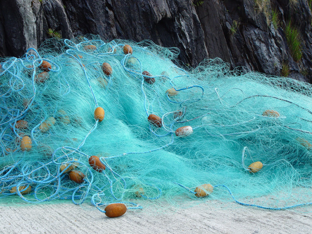 Fishing net bundled up in a pile