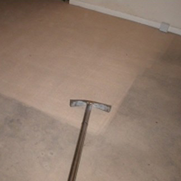 Cleaned and uncleaned areas of a carpet
