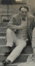 Photo of Desmond MacCarthy in 1912, seated on steps