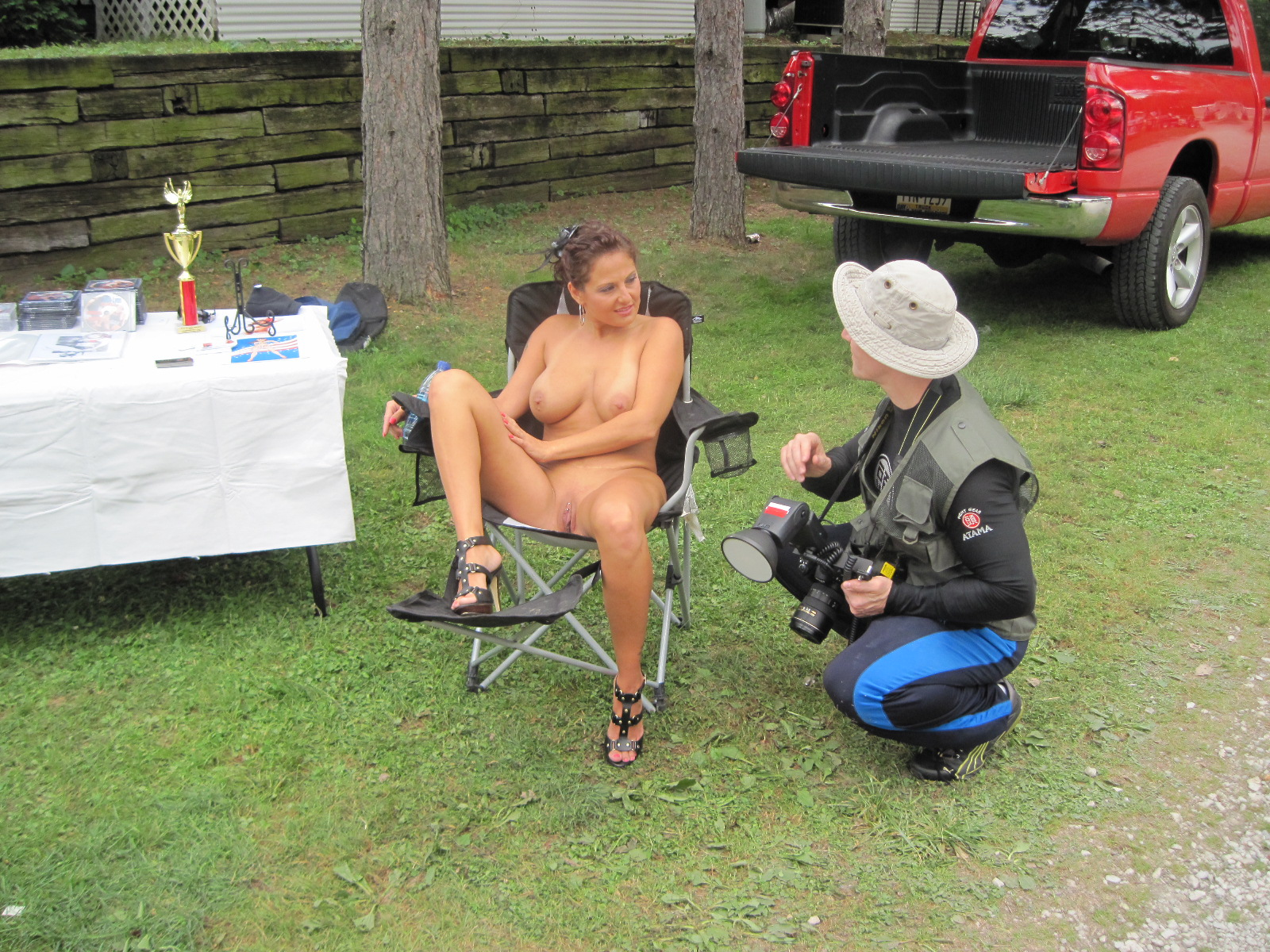 Description Nude Woman Sitting In A Camping Chair