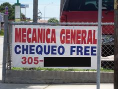 A sign offering free consultation from a mechanic, taken in Miami, Florida.
