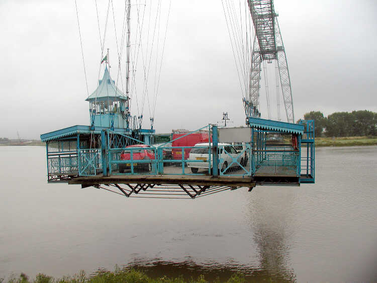 The Newport Transporter Bridge is a crossing of the River Usk in Newport, South Wales in the United Kingdom. It is a Grade I listed structure. Designed by French engineer Ferdinand Arnodin, it was built in 1906 and opened by Godfrey Charles Morgan, 1st Viscount Tredegar on 12 September 1906. The span is an example of the very rare transporter bridge concept, of which only eight exist worldwide.