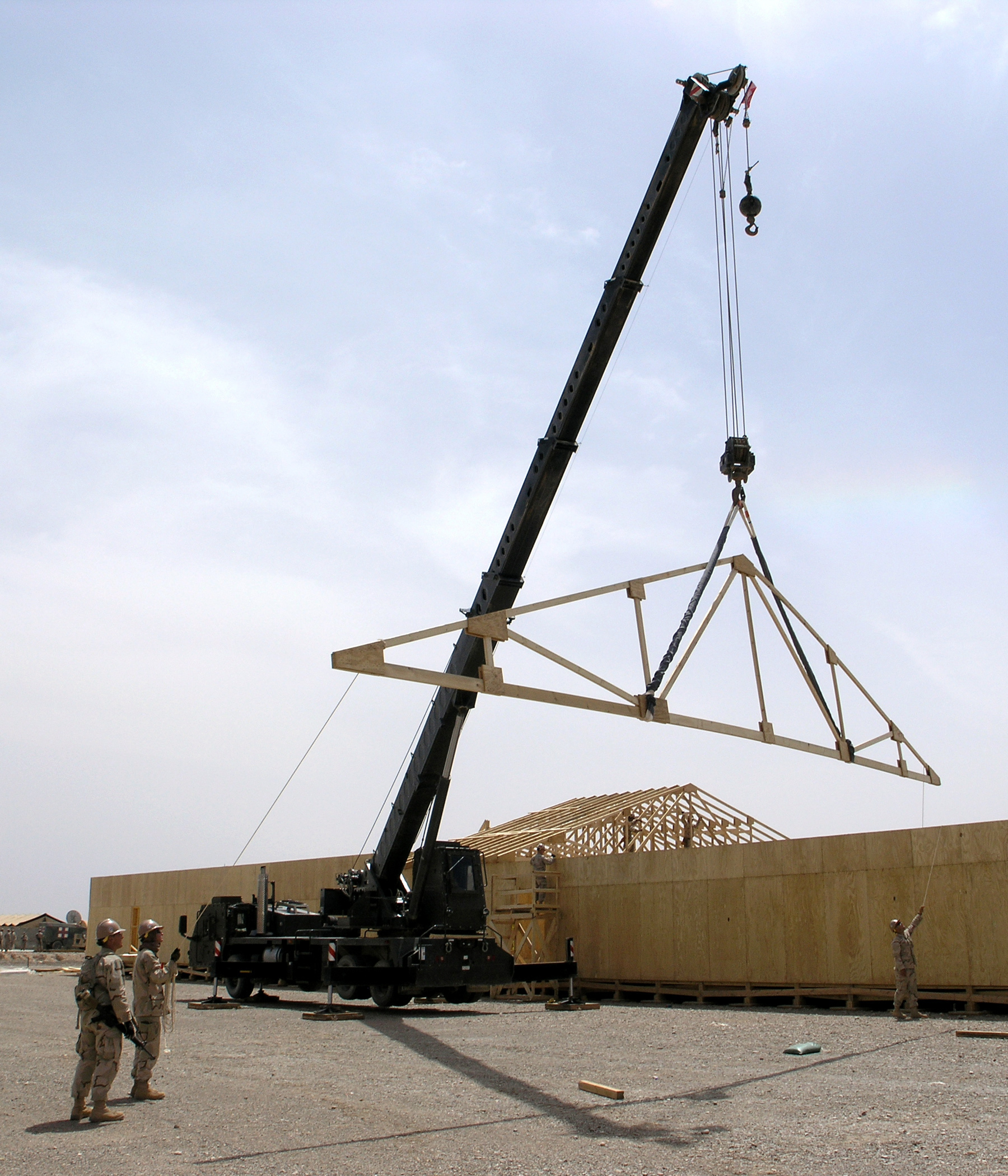 File Us Navy 090417 N 9599t 027 Seabees Use A Crane To