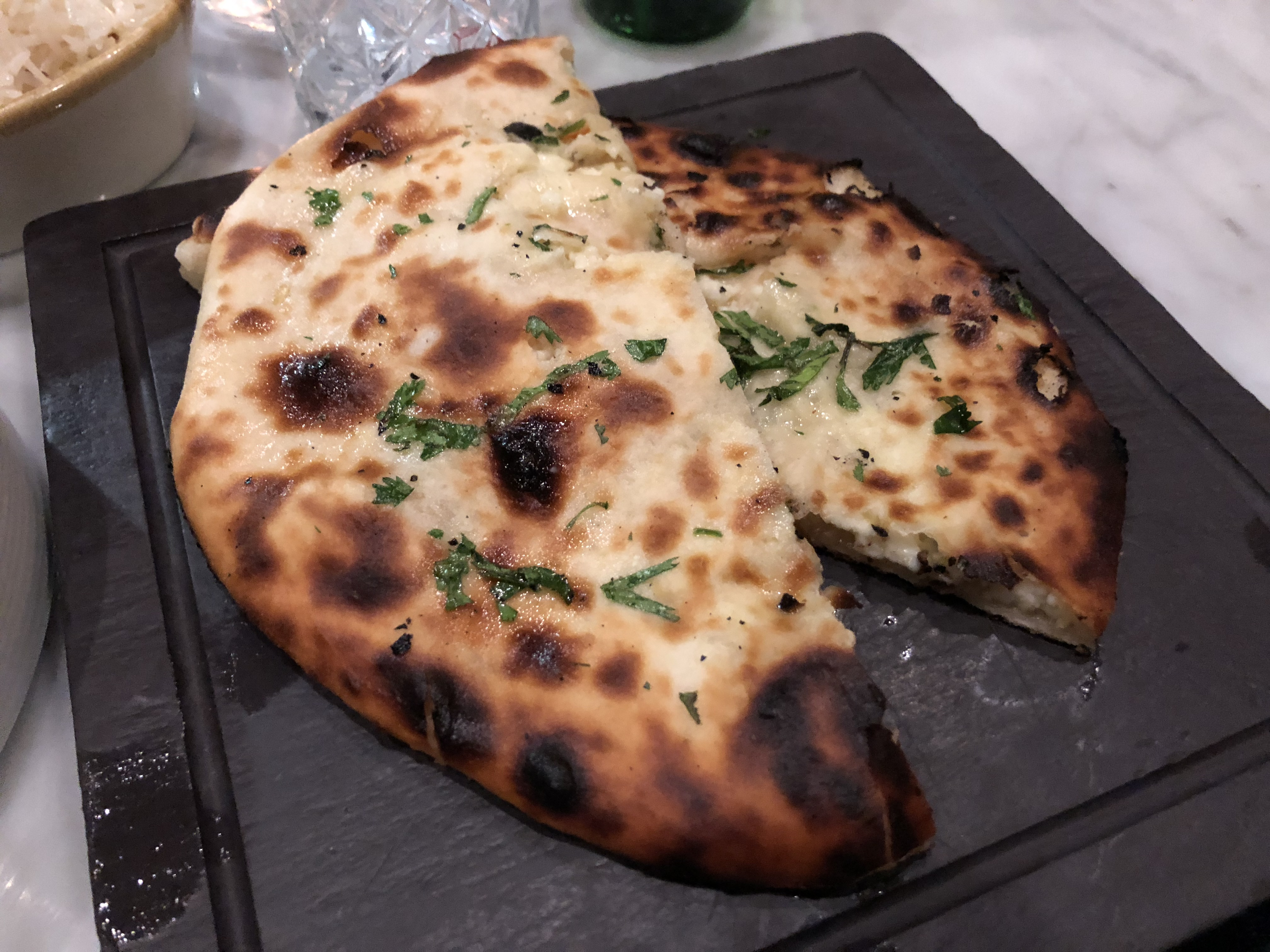 File:2020-02-22 20 57 14 Mixed herb and cheese naan bread at Karma Modern  Indian in Washington, D.C.jpg - Wikimedia Commons