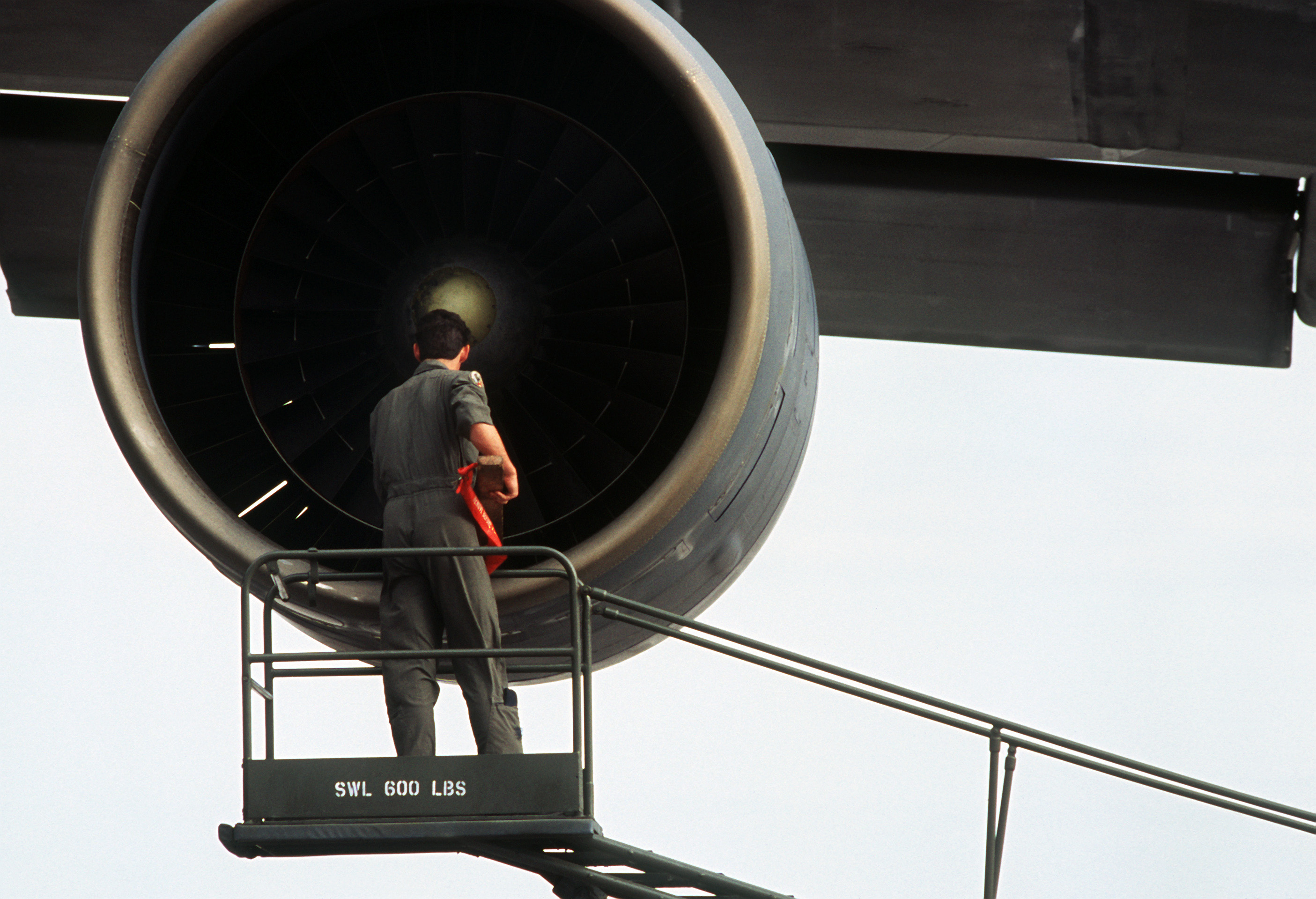 File:A crew chief inspects an engine of a 436th Military