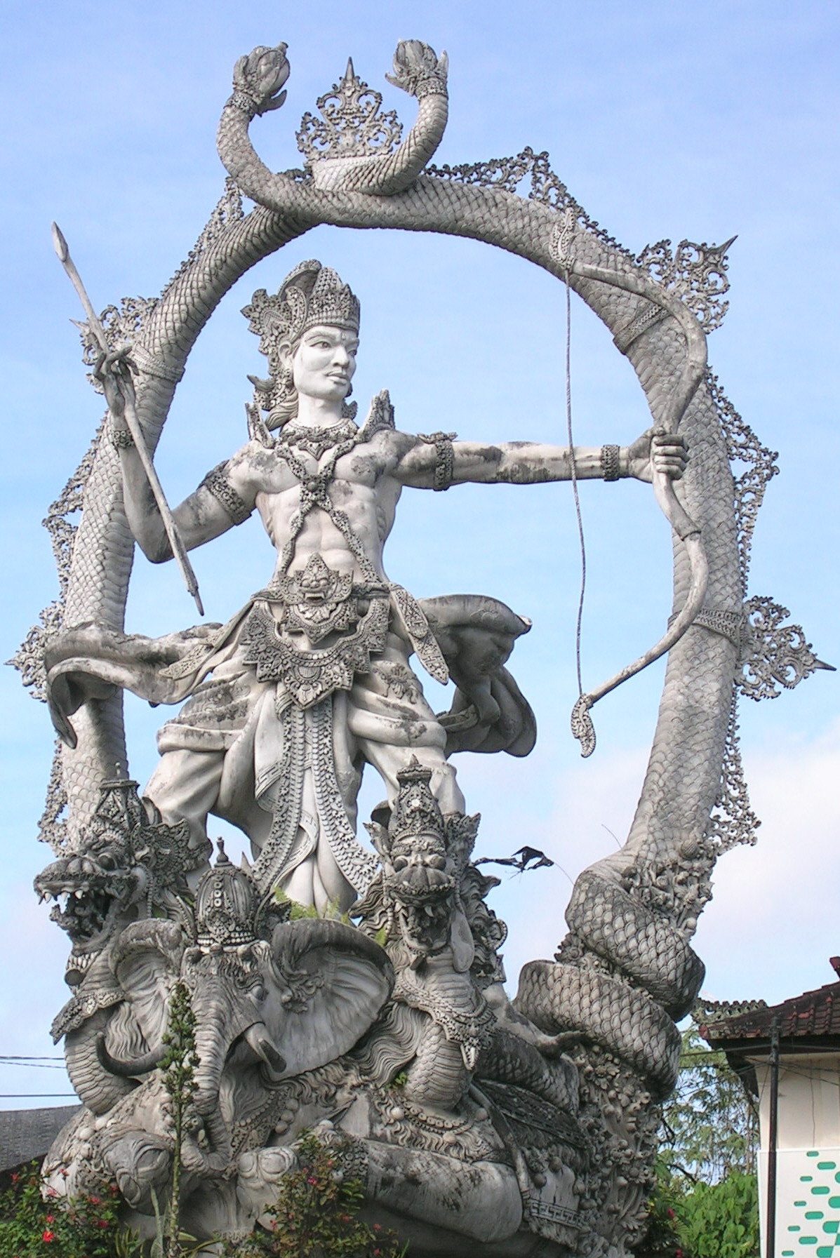 A statue of Arjuna on a street in Bali