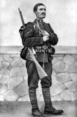 standing photo of Mussolini in 1917 as an Italian soldier