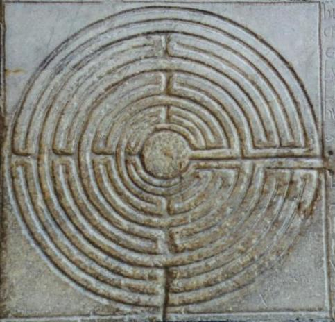 An image of a Labyrinth carved in relief.