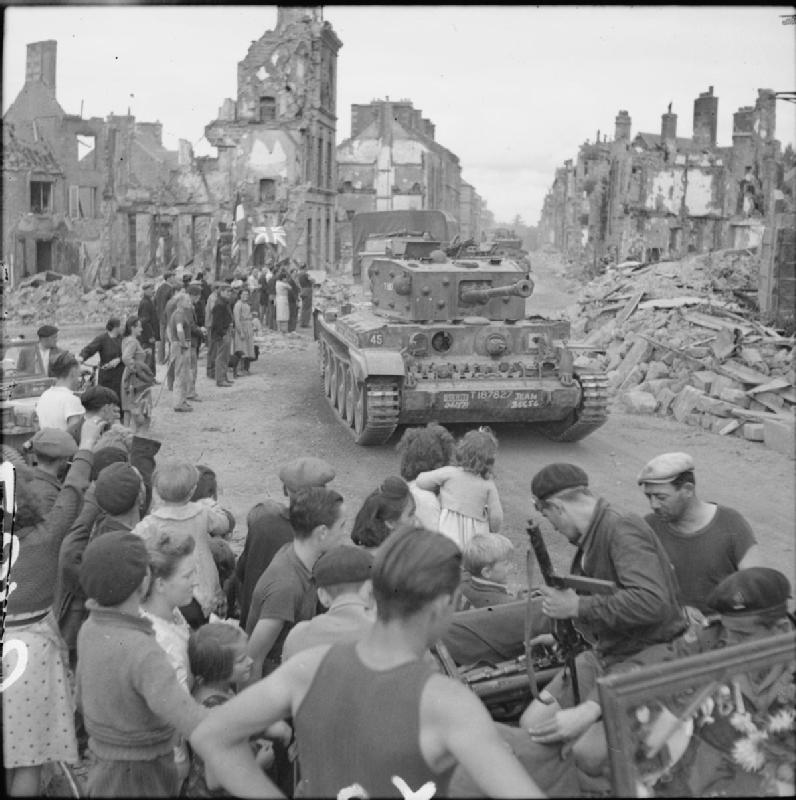 Cromwell of the 2nd Northamptonshire Yeomanry passes  through Flers