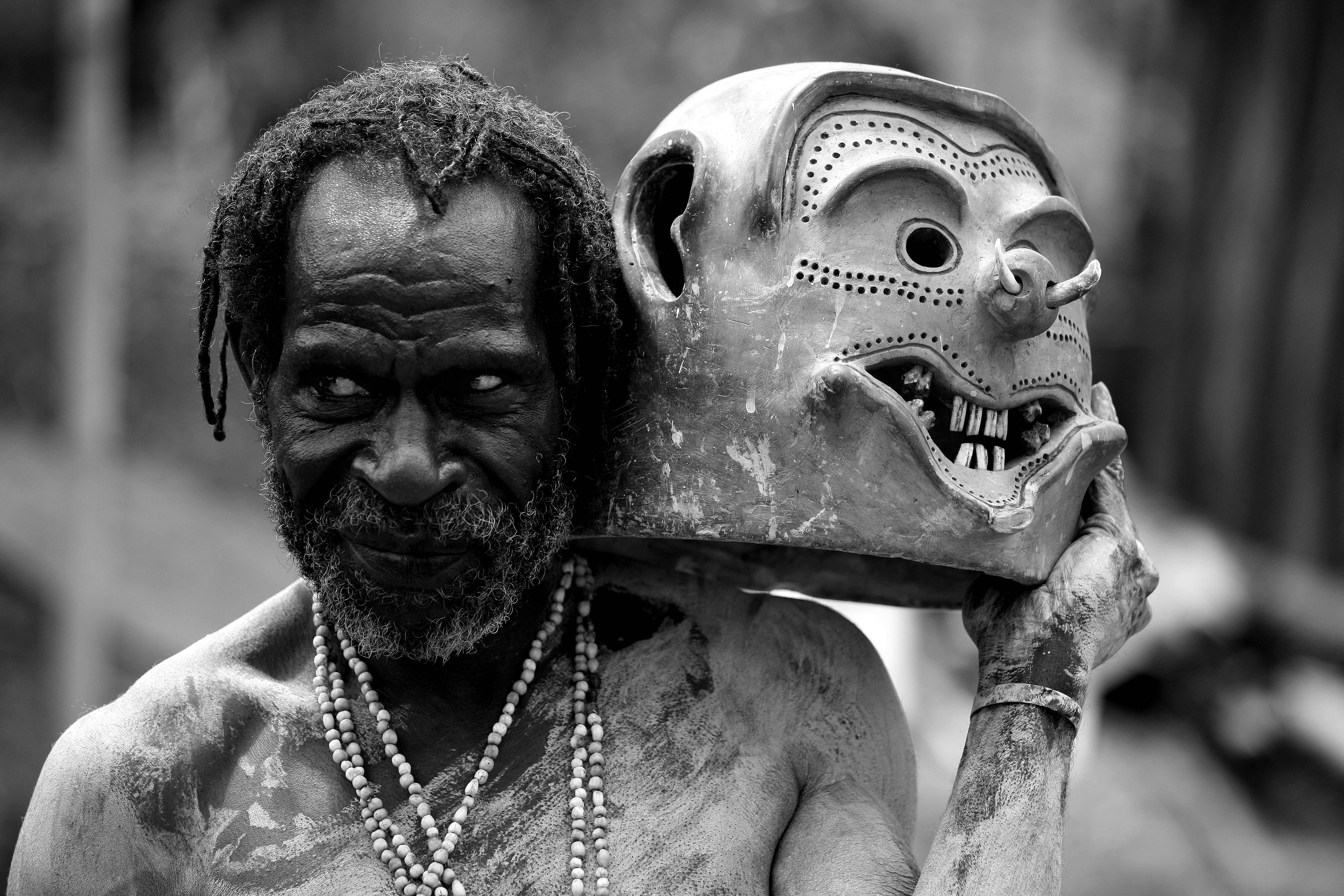 Asaro mudman holding mask, Papua New Guinea