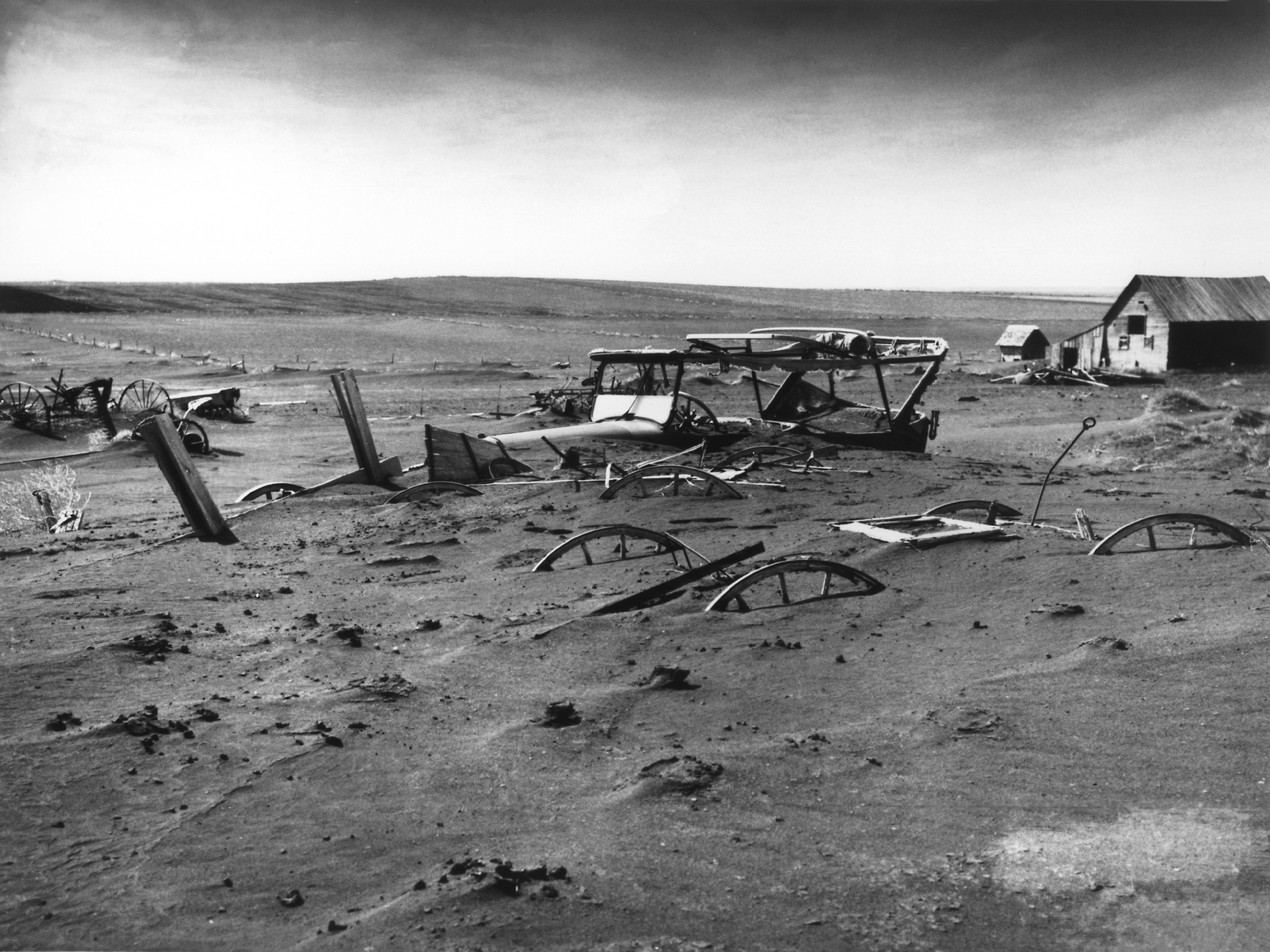 great depression  buried machinery in a barn lot south dakota 1936 the dust bowl on the great plains coincided the great depression