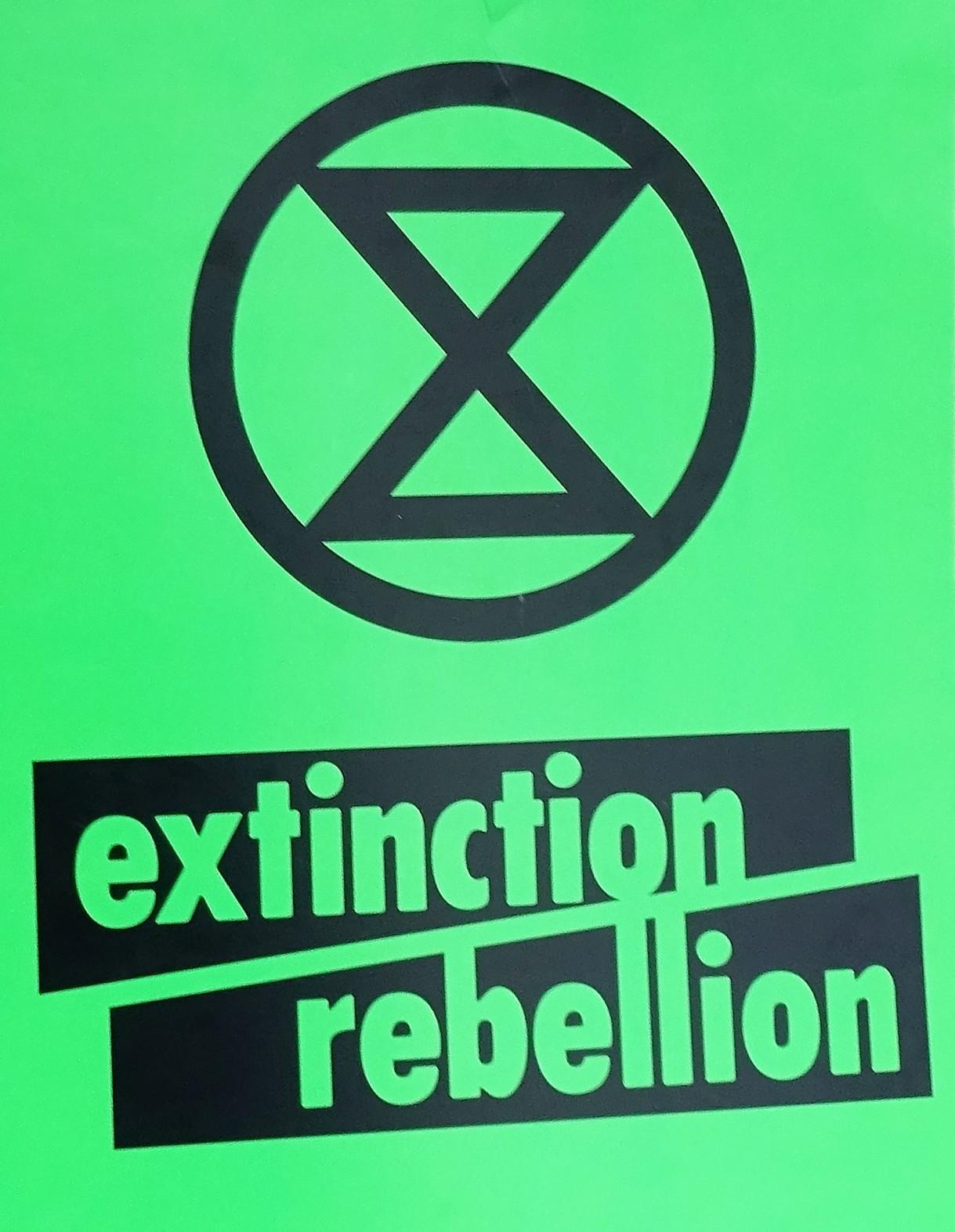 Extinction Rebellion, green placard (cropped).jpg