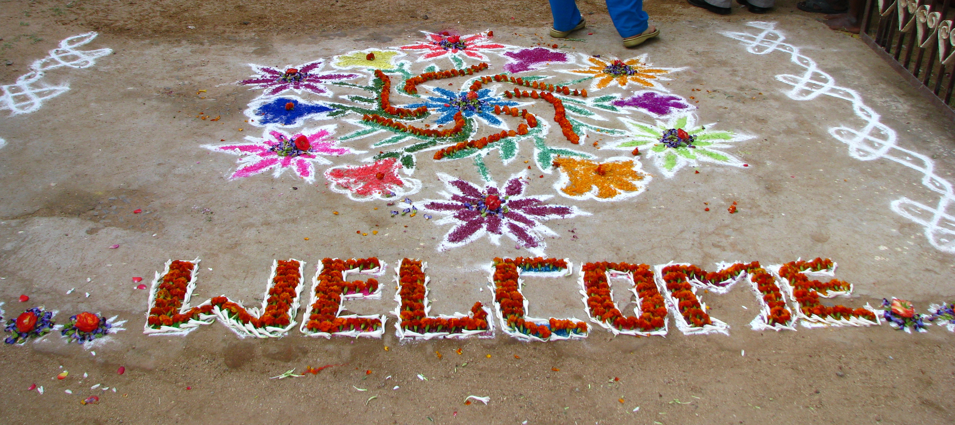 File:India - Sights & Culture - Chalk & flower welcome ...
