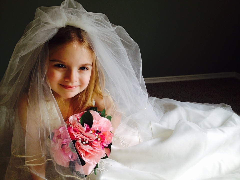 Little girl wearing a white wedding dress 1.jpg