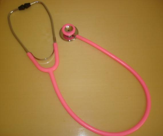 acoustic stethoscope with the bell upwards