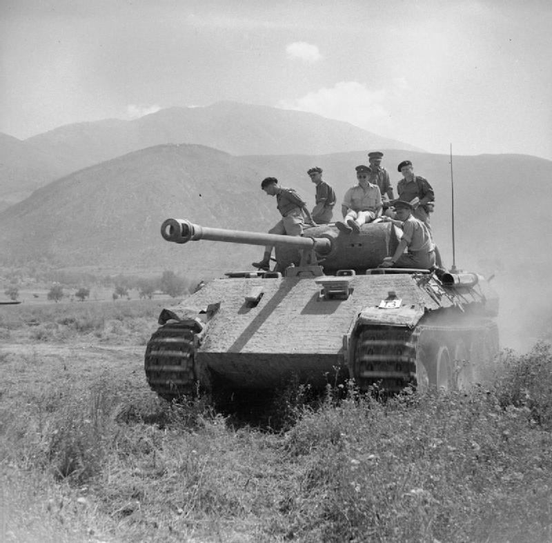 Lieutenant-General Oliver Leese ride on a captured Panther tank