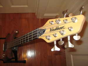 headstock of a washburn rb2802 eight-string bass