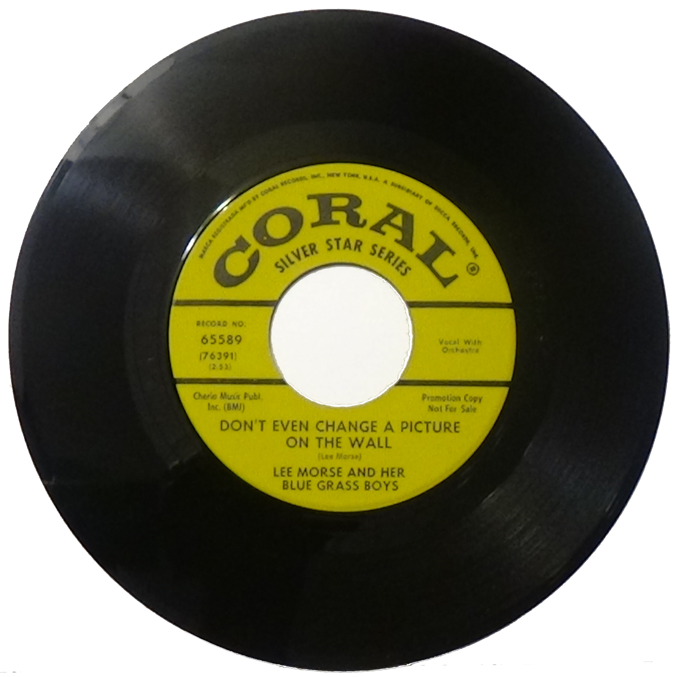 Typical 45-rpm single record with large central hole for jukeboxes and other players with a 1 /2-inch hub 45rpm.jpg