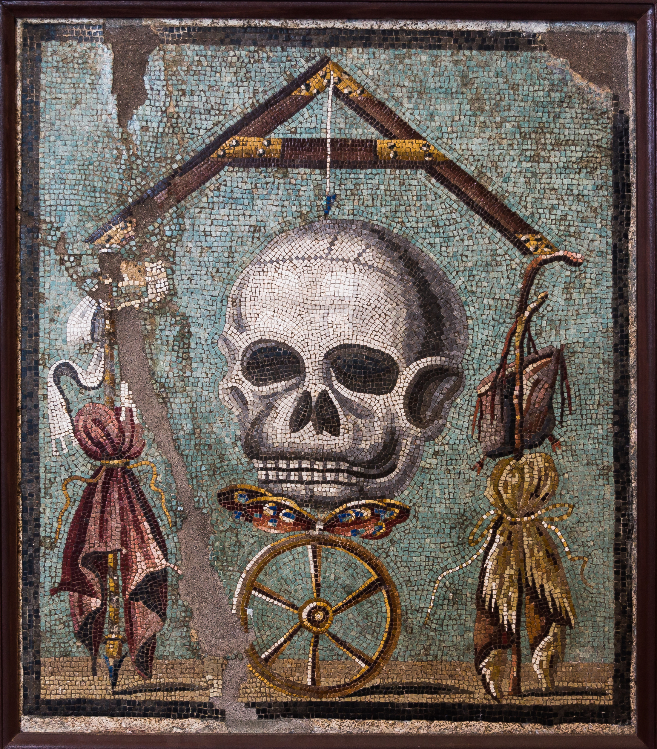 An image of a memento mori mosaic, featuring a butterfly to represent the soul.