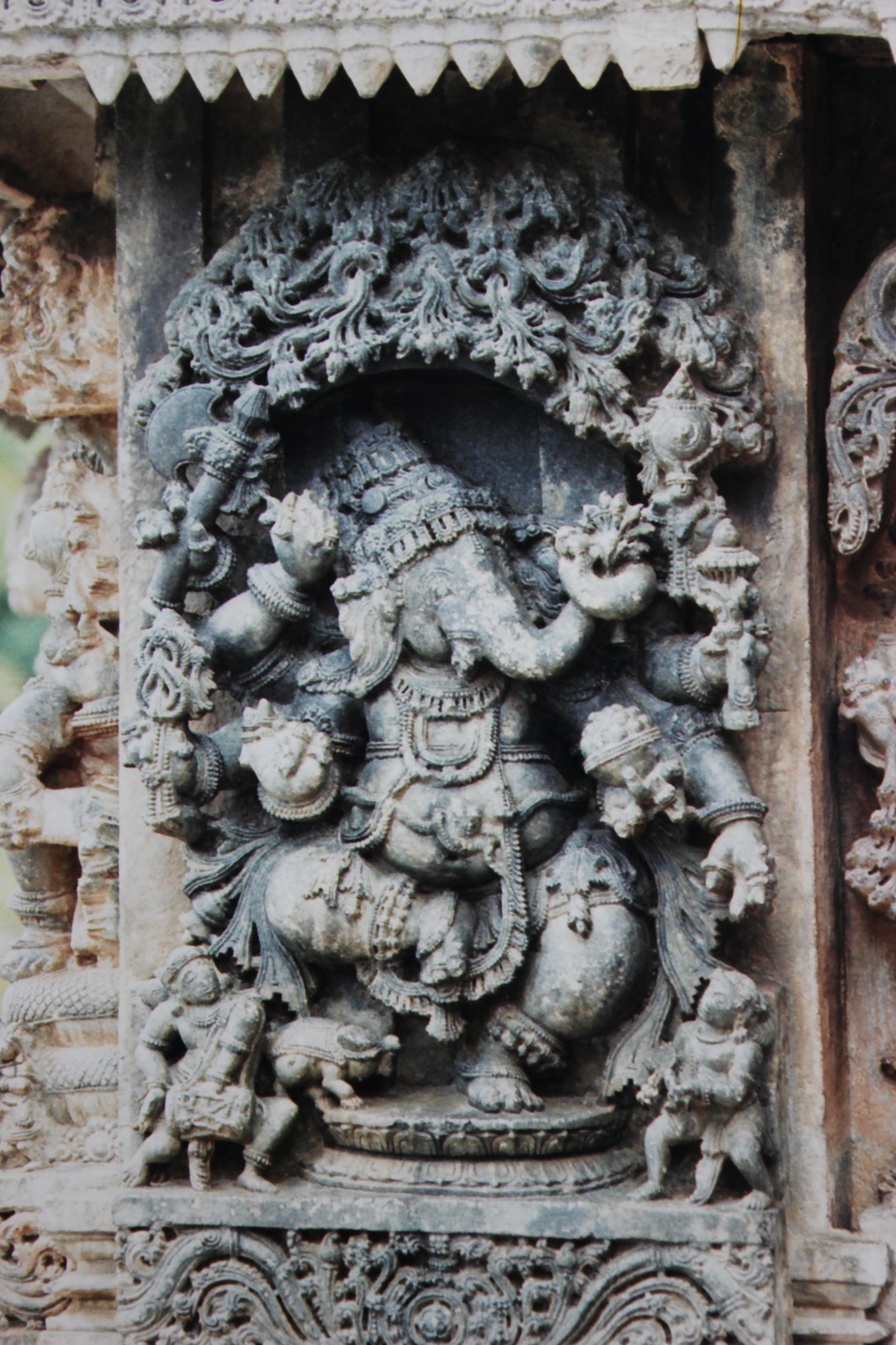 File relief sculpture of dancing ganesha in lakshmi