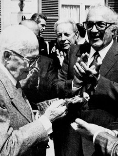 Italian President Sandro Pertini receiving a David di Donatello Award from Fellini in 1985