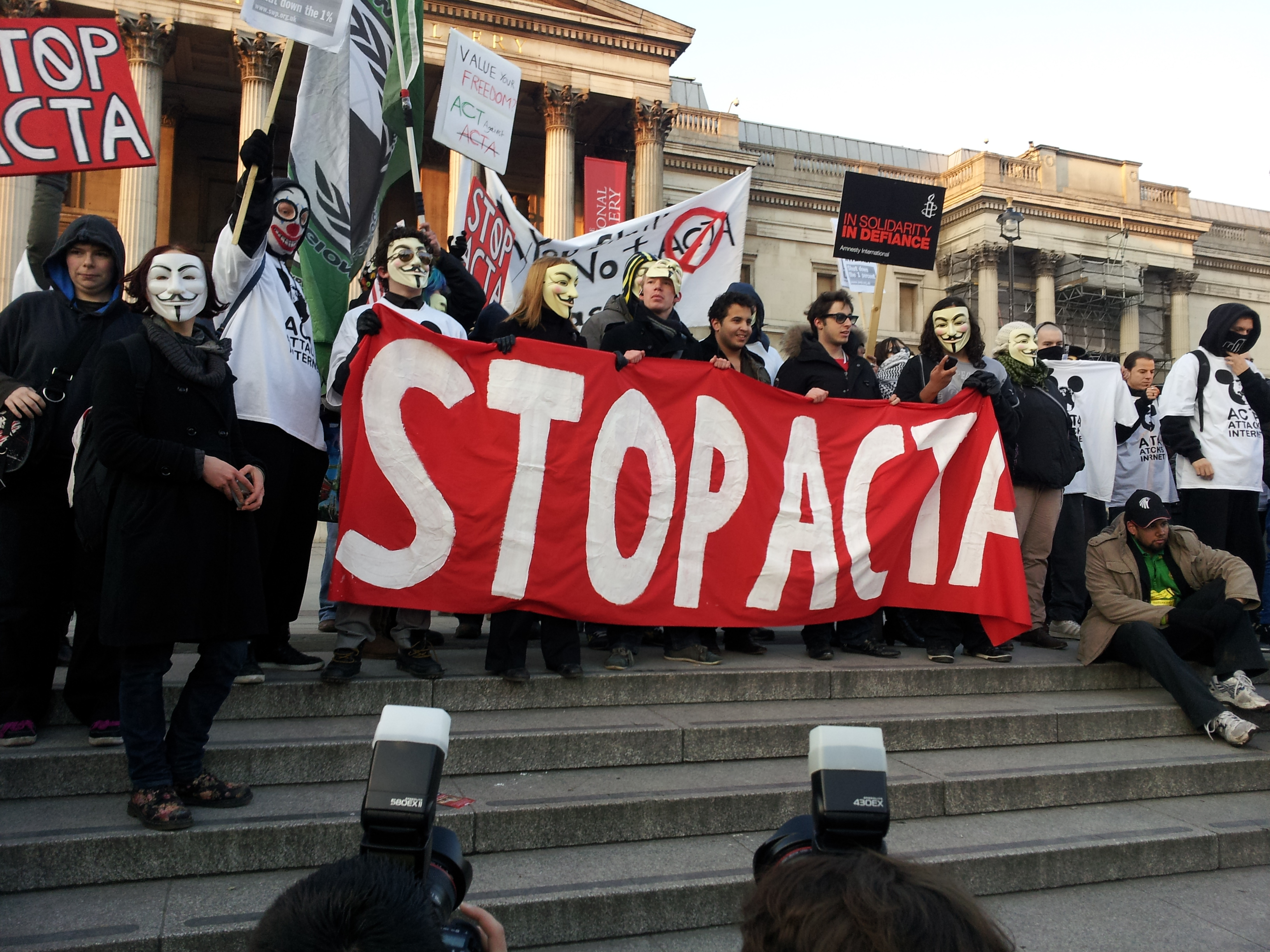 File:Stop ACTA Anonymous 2011 protest.jpg - Wikimedia Commons