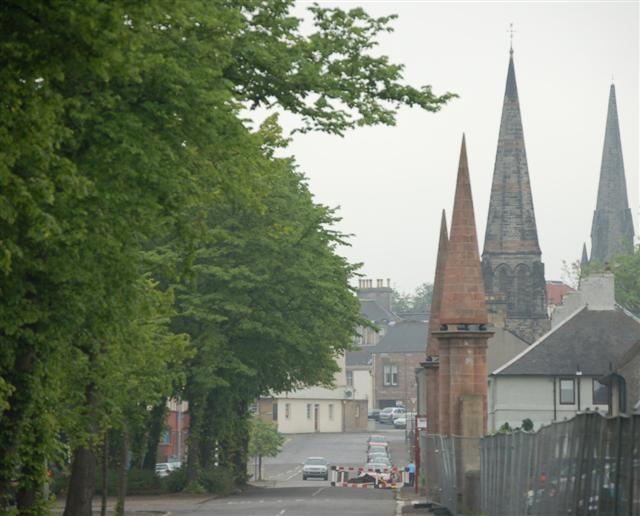 View toward the centre of Alloa, Clackmannanshire, from Lime Tree Walk. The spire furthest right is the former Chalmer's Church, now a nightclub, in Bank Street. The next spire is St John's Episcopalian church in Broad Street. The two small spires are gate piers of the now-demolished Alloa House.