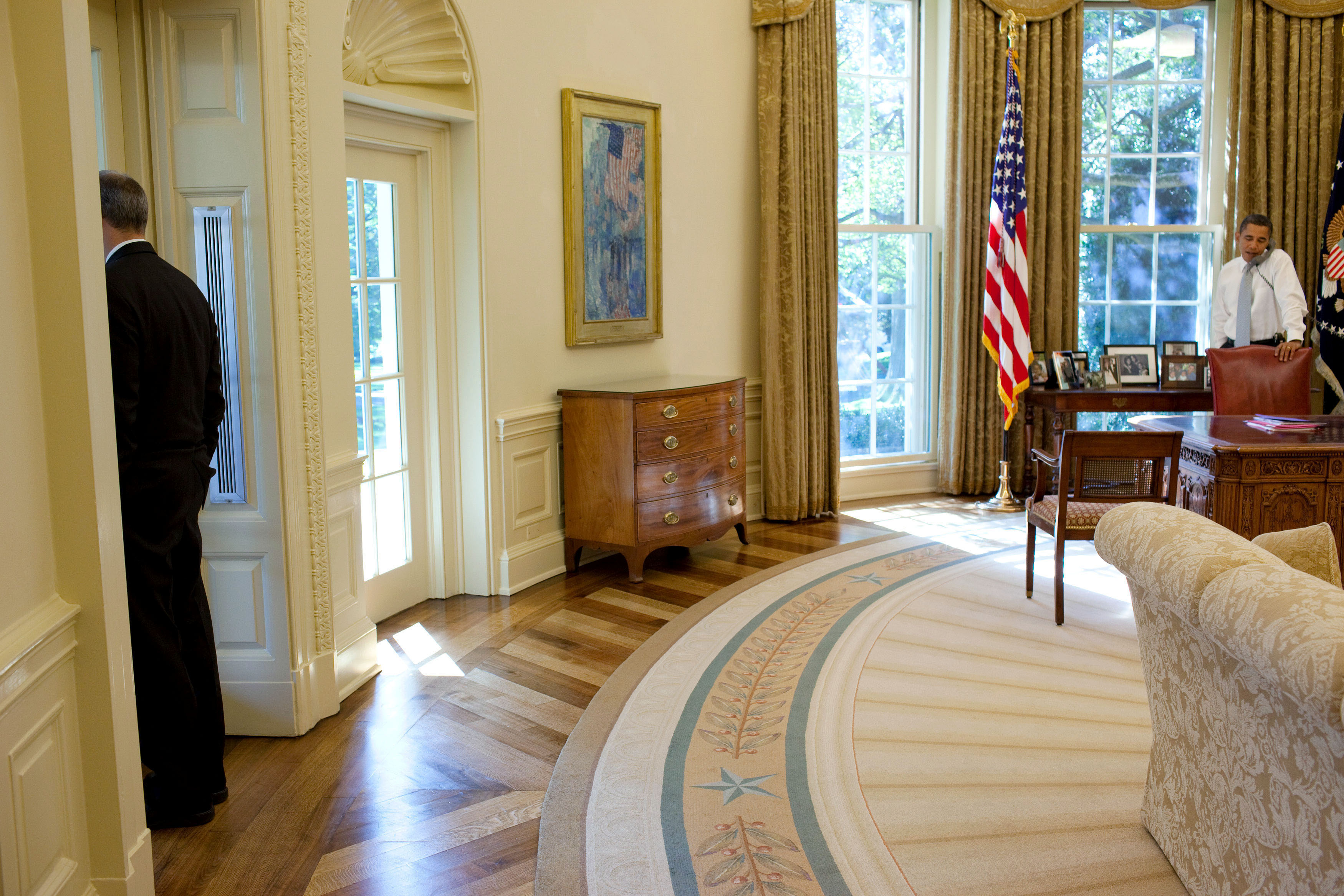 File:Barack Obama in the Oval Office, Phil Schiliro looks out the window.jpg