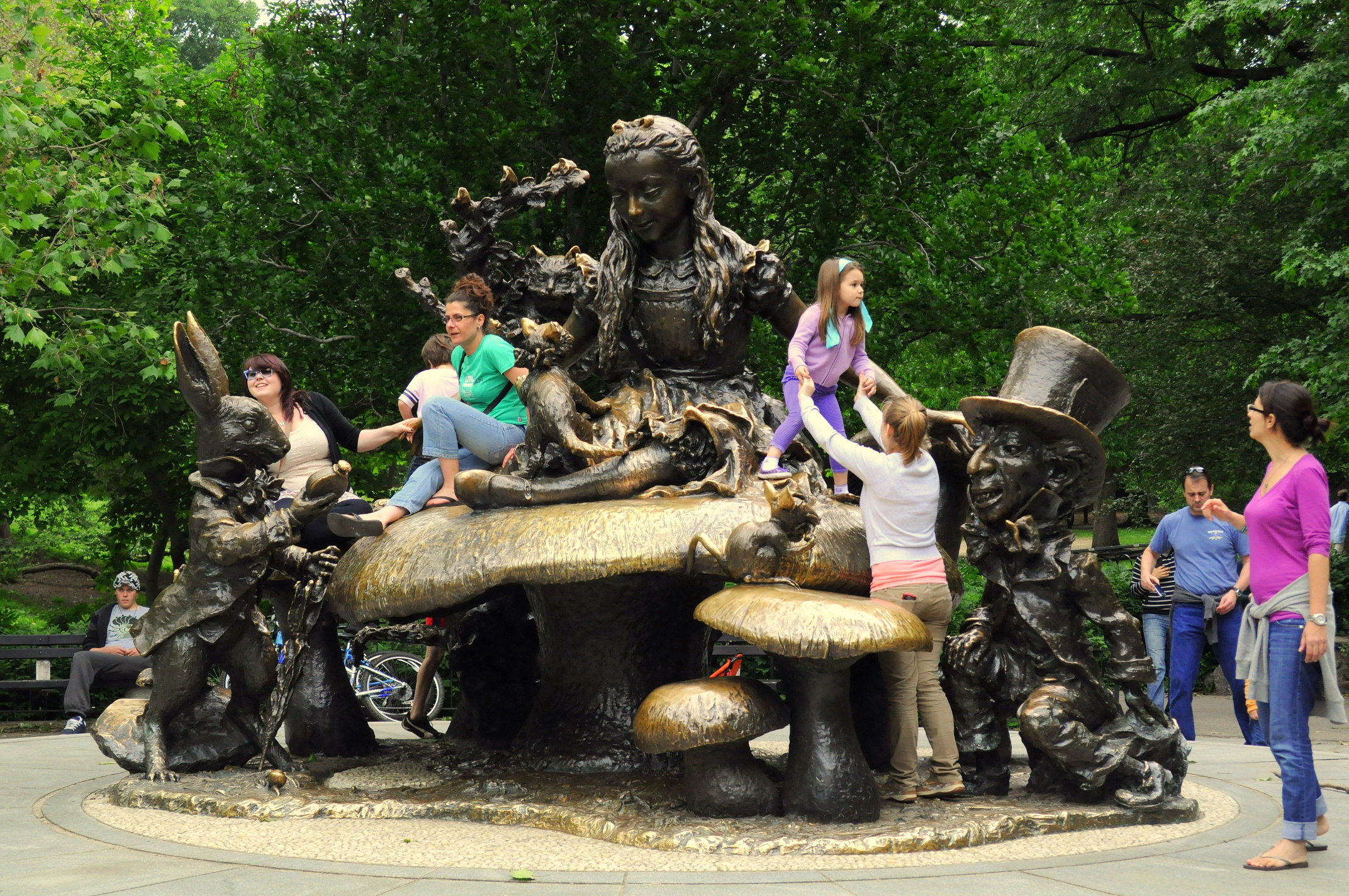 file children play on alice in wonderland sculpture central park new