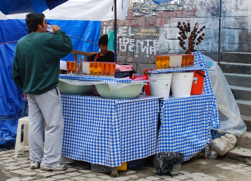 Drinking mocochinchi in market in La Paz