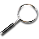 Icon of a magnifying glass.