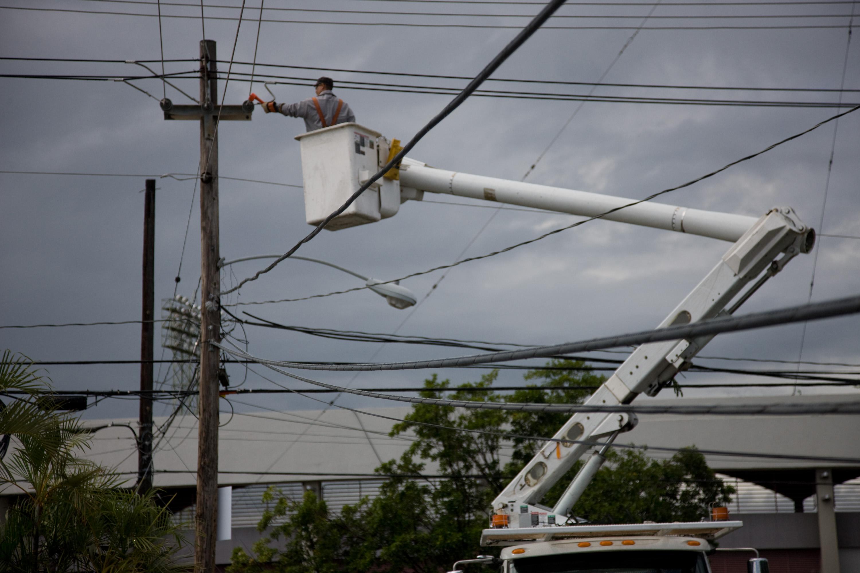 File:FEMA - 39177 - Electric company repairing a power ...