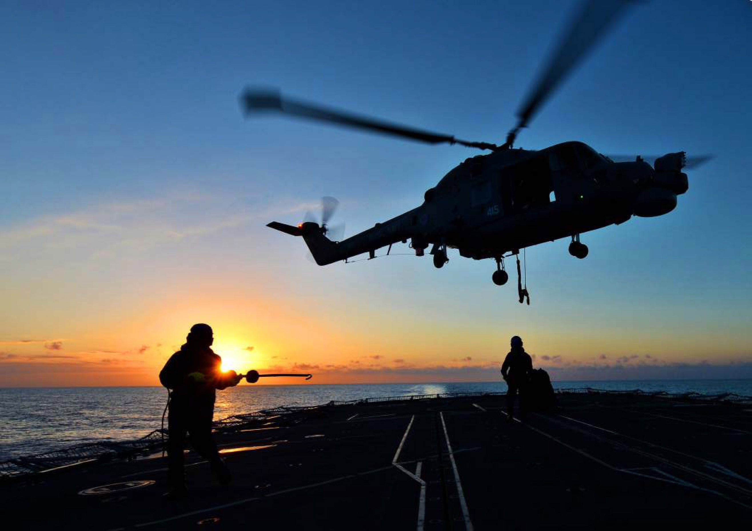 file:lynx helicopter hovers over hms monmouth at sunset mod 45154614