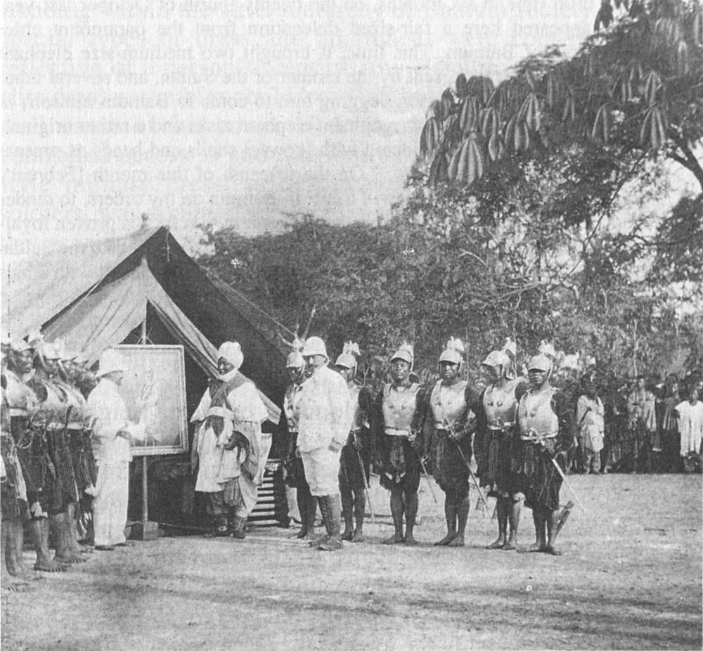King Njoya of Bamum receiving an oil painting of Kaiser Wilhelm II. The gift was in return for his support in the German campaign against the Nso'. Bamum, German Kamerun. 1906. [1000x926]