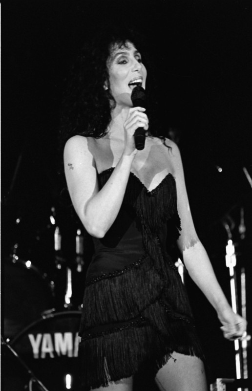 Cher performing during a benefit concert for Elizabeth Glaser Pediatric AIDS Foundation in 1989