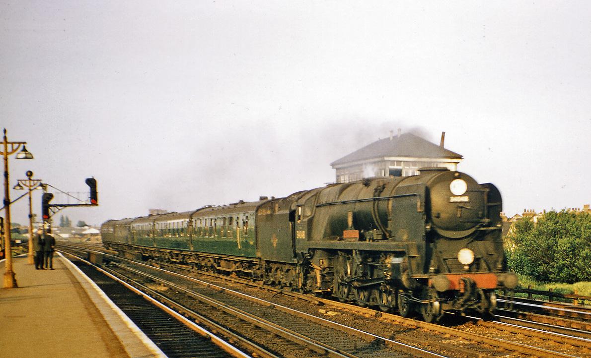 Raynes Park Waterloo   Salisbury train passing geograph 2669234 by Ben Brooksbank - London's cutest signal gantry?