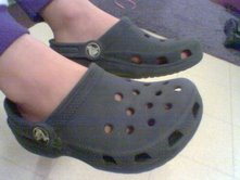 A boy wearing Crocs