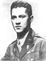 A young looking Caucasian man with dark hair and eyes in a US Army uniform with several decorations