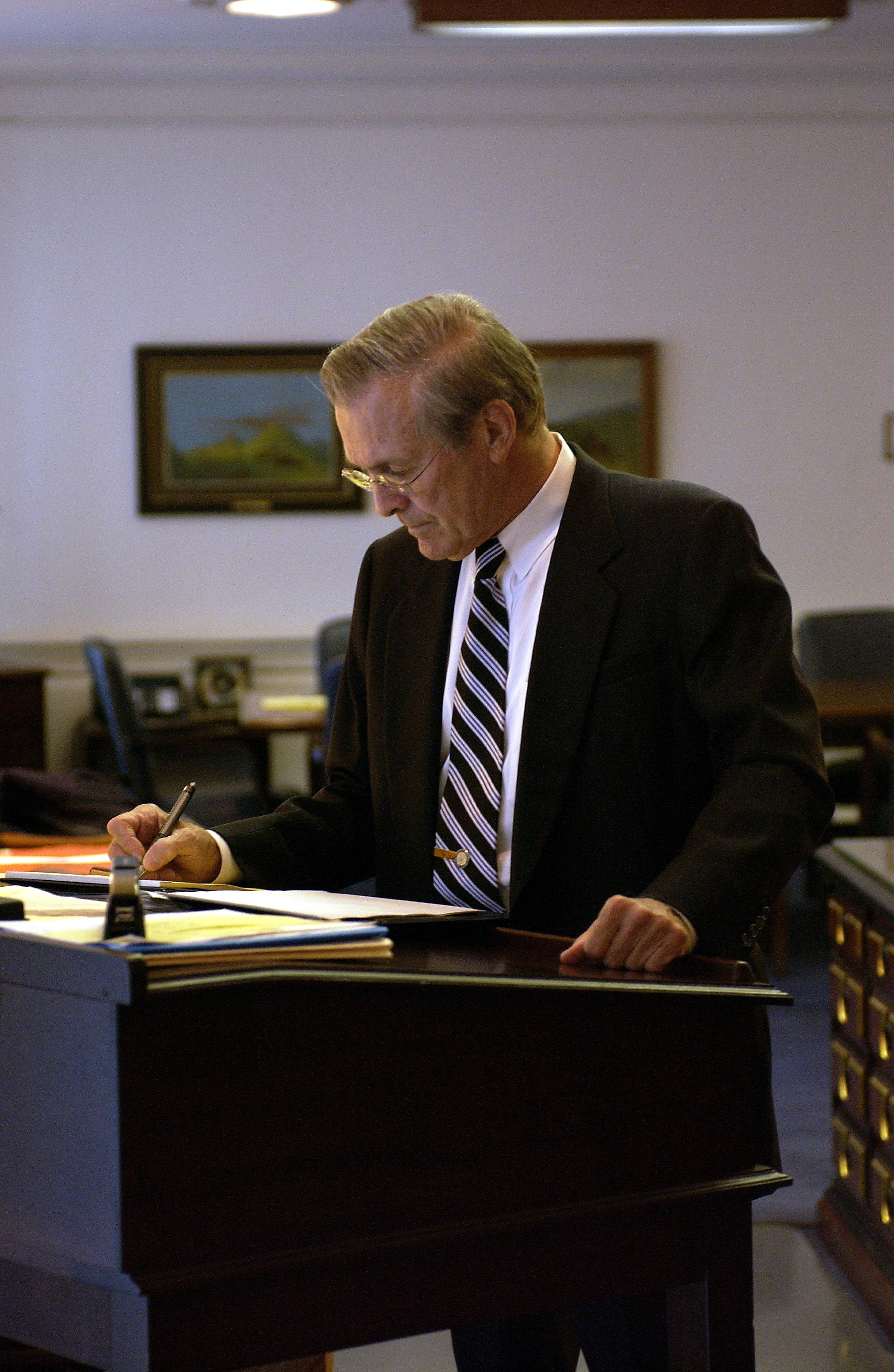 File:Donald H. Rumsfeld works at a stand-up desk.jpg - Wikimedia Commons