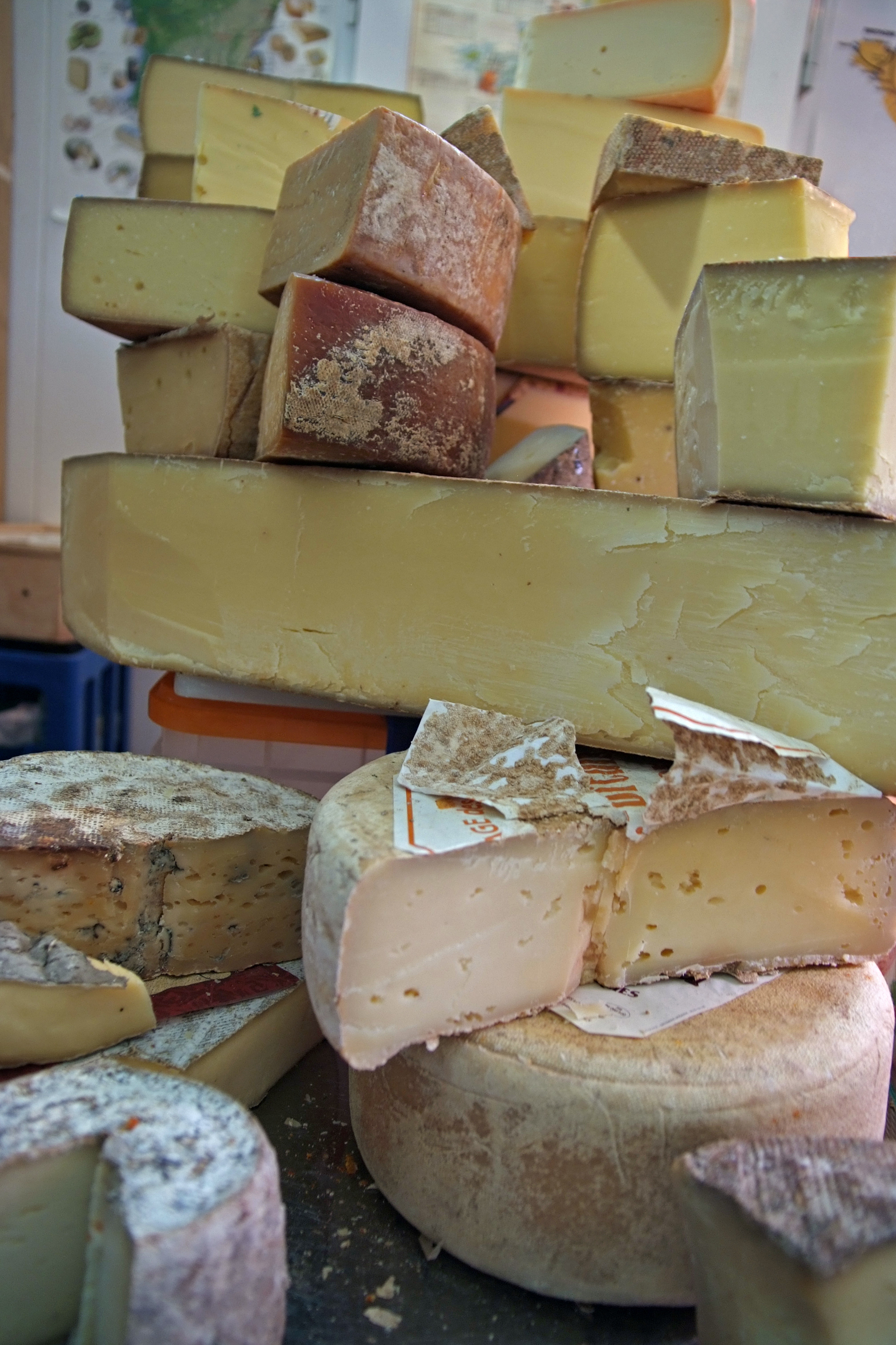 A towering pile of cheeses