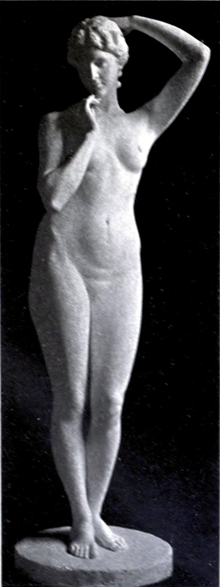 statue of nude woman with one hand on top of her head