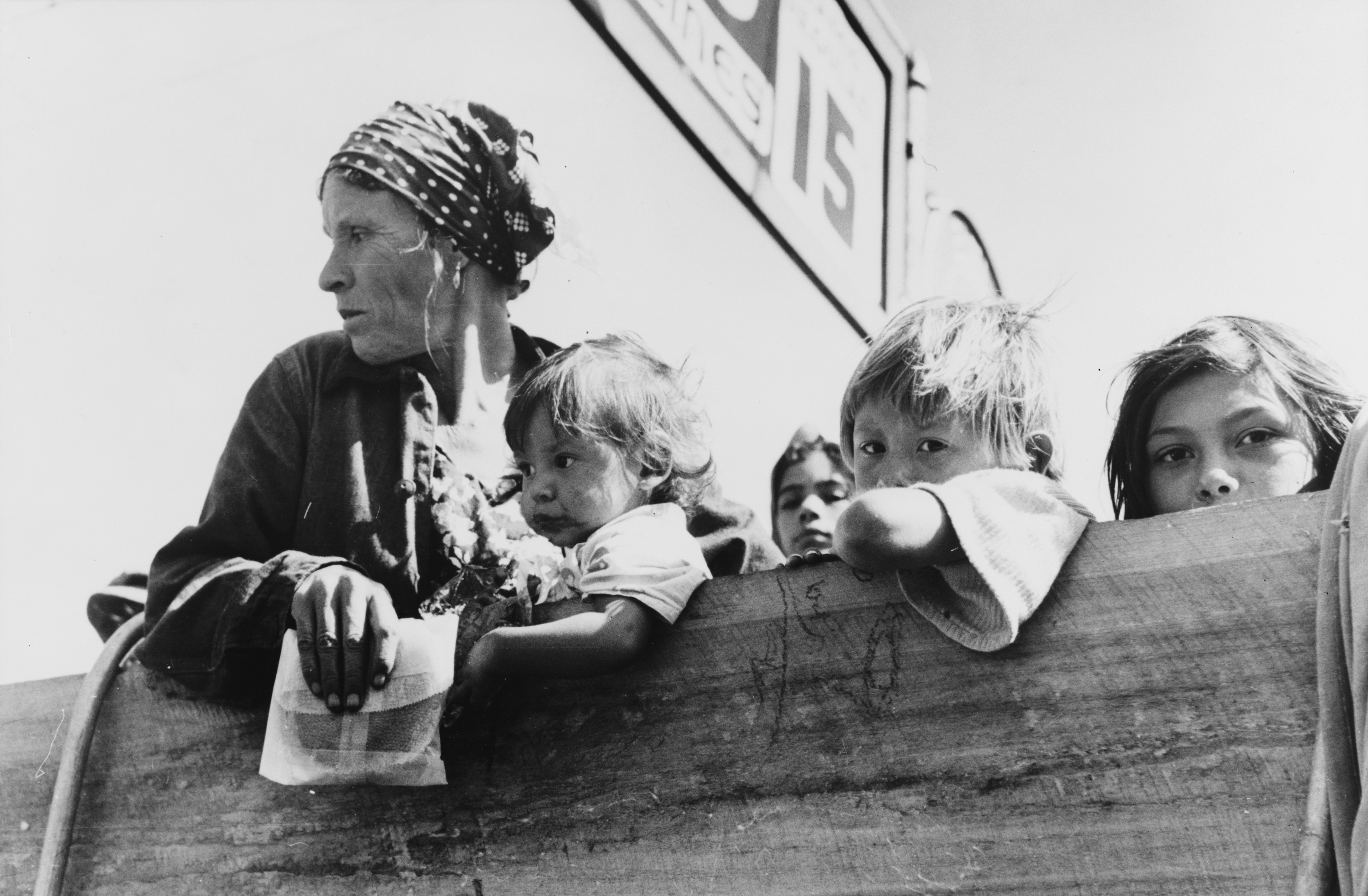 File Mexican Woman And Children Looking Over Side Of Truck