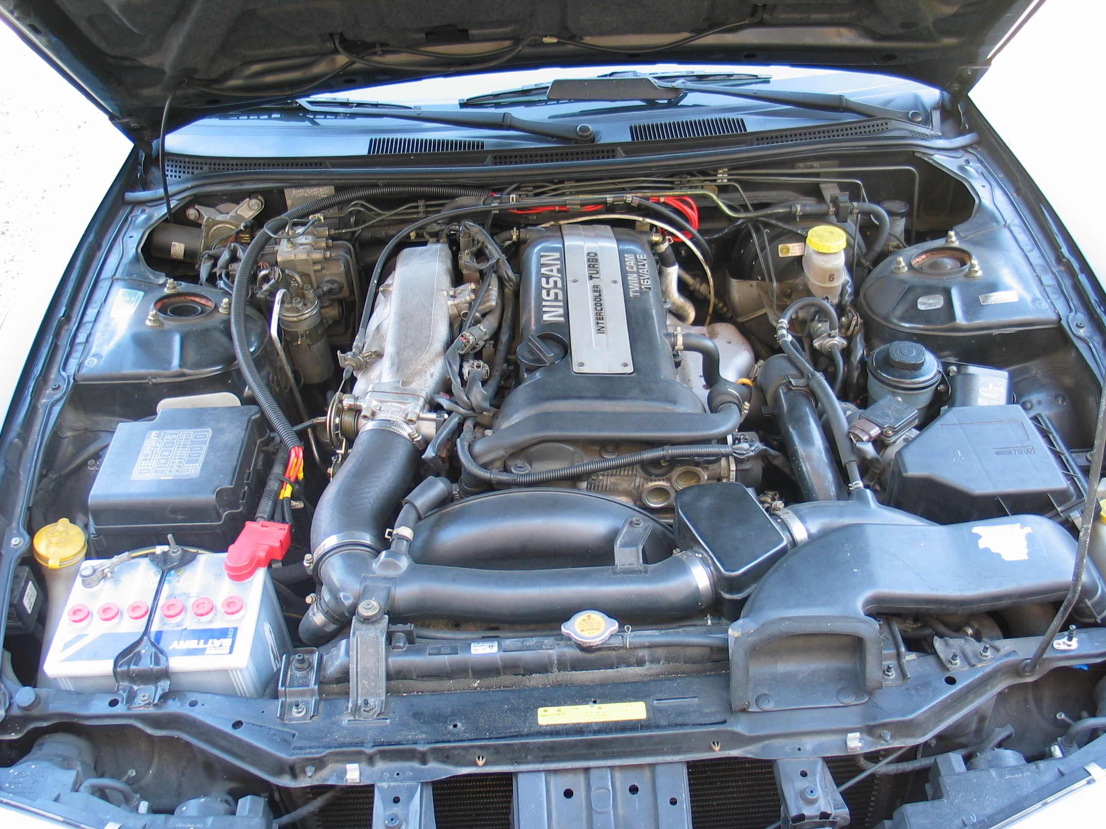 file nissan 200sx s14a engine bay stock jpg wikimedia commons rb20det s13 engine bay file nissan 200sx s14a engine bay stock jpg