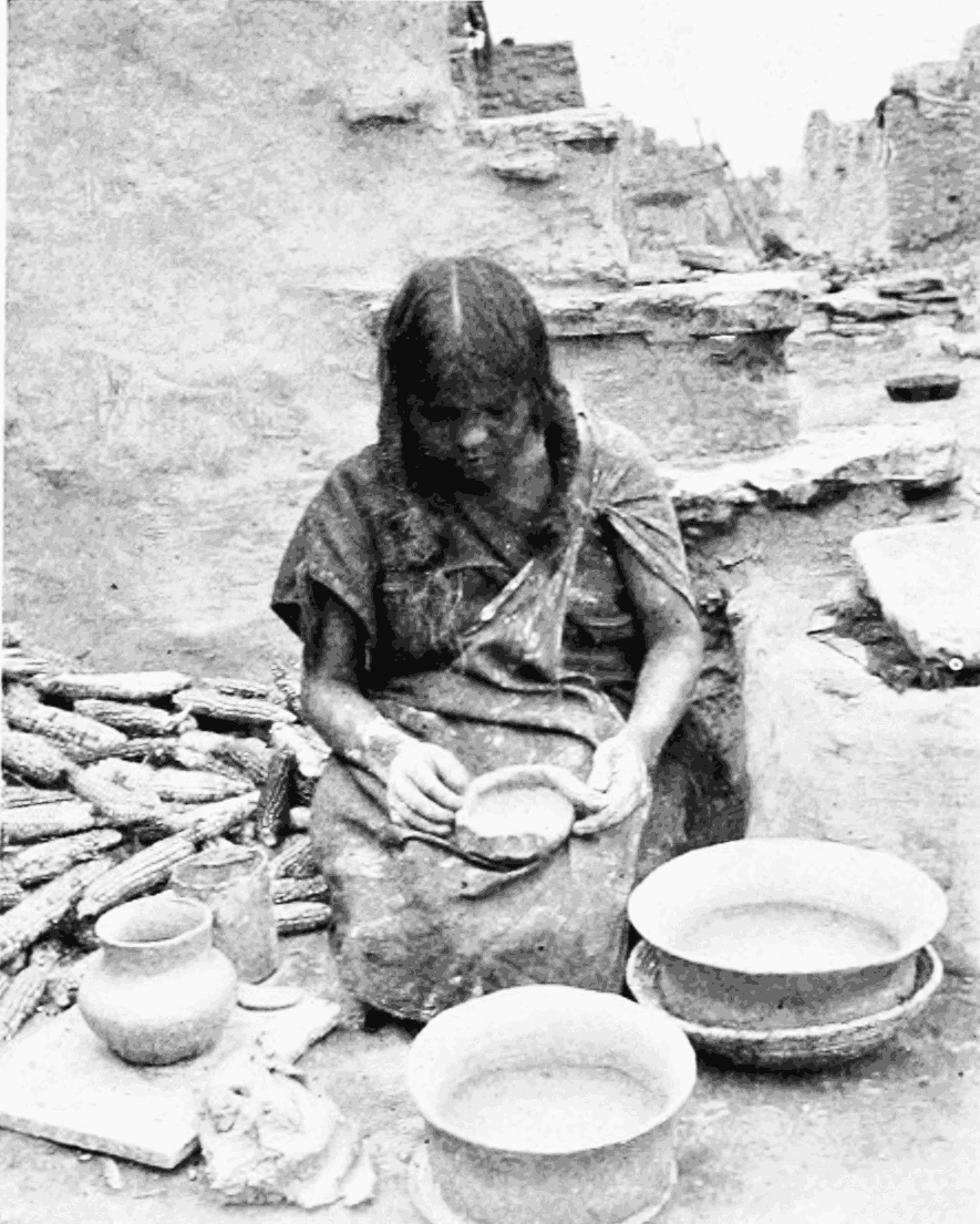 PSM V55 D763 Woman of oraibi making coiled pottery.png