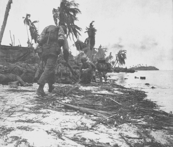 First assault wave of Marines take cover prior...