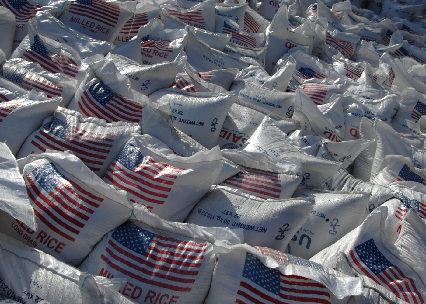 File Us Navy 100213 N 5961c 004 Bags Of Rice Are Staged For Distribution At An Aid Distribution