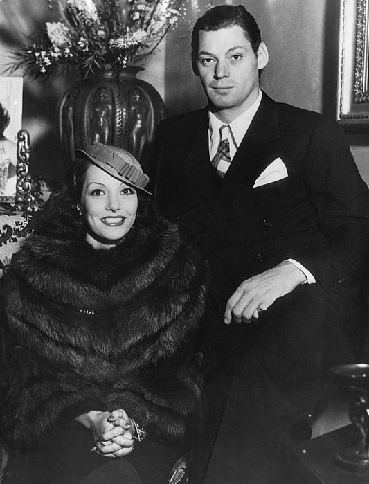 With his second wife, the Mexican actress Lupe Vélez in a newspaper press photo (1934)
