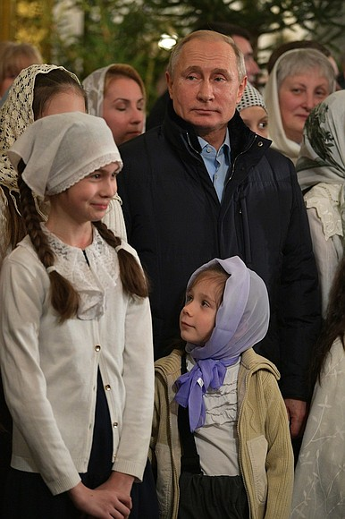Vladimir Putin celebrates Christmas with orthodox Christians in St Petersburg (2019-01-07) 3.jpg