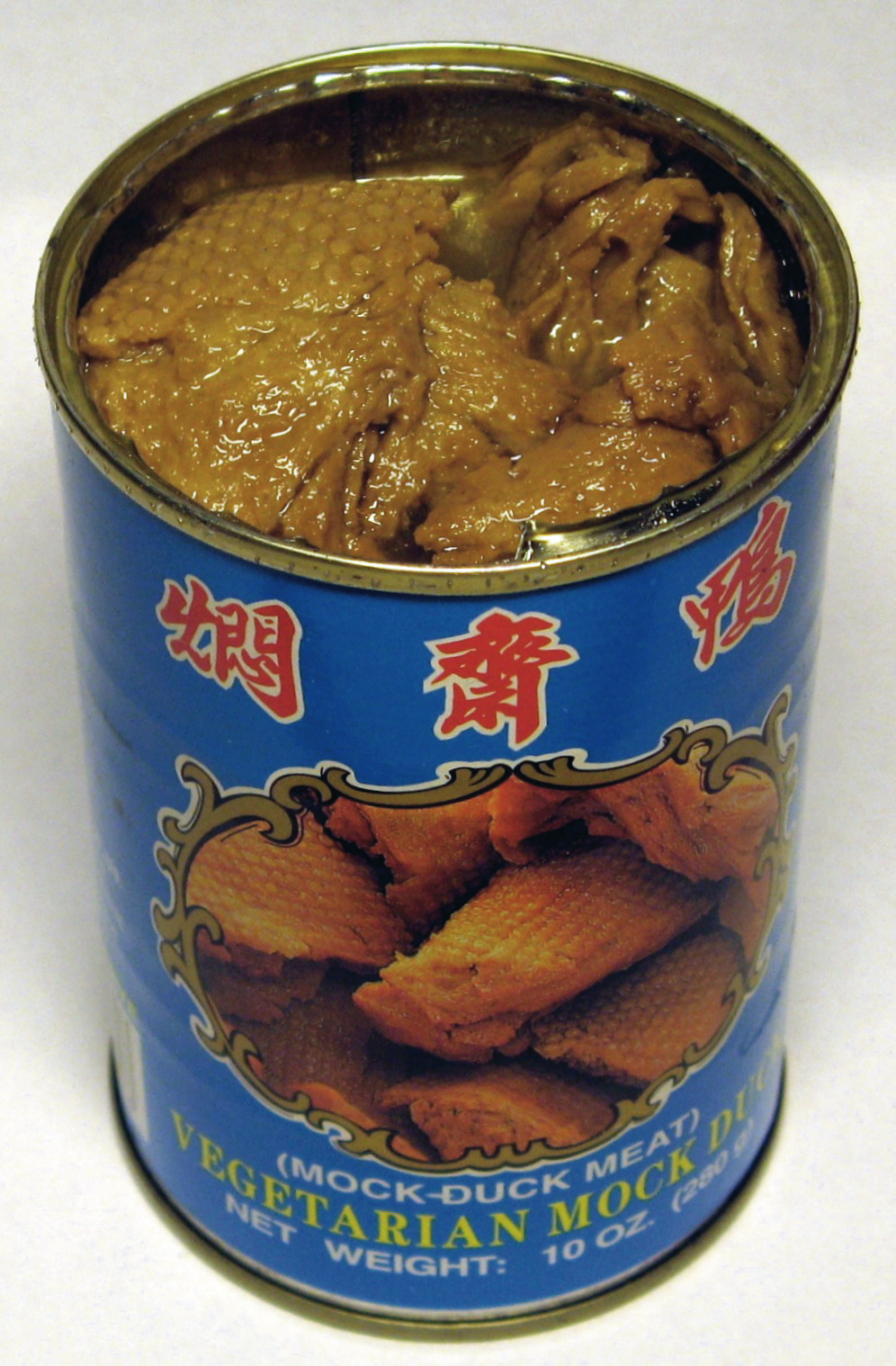 https://upload.wikimedia.org/wikipedia/commons/f/f2/Wheat_gluten_%28vegetarian_mock_duck%29_opened_can_%282007%29.jpg